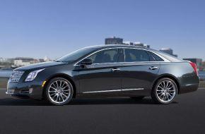 Черный седан Cadillac XTS