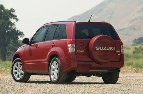 Красный Suzuki Grand Vitara