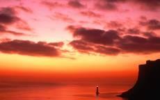 Скалы, маяк, красный закат, океан, облака