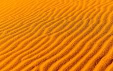 пустыня, ярко желтый песок, волны на песке