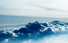 Над синими облаками.