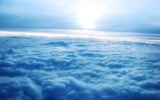 Над голубыми облаками.